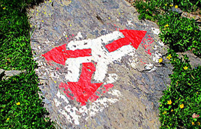 Swiss-hiking-arrows-on-a-rock-redirect